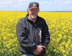 Frank Young in a canola field.