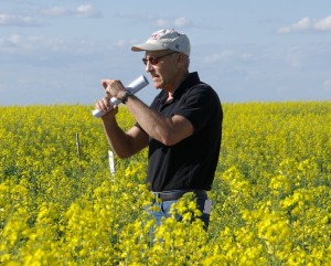 William Schillinger speaking in a canola field.